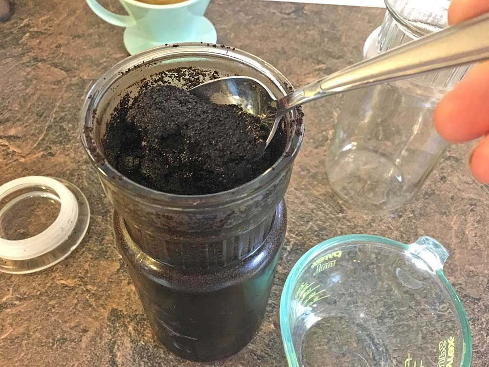 Make Your Own Iced Coffee - Scoop out extra ground coffee